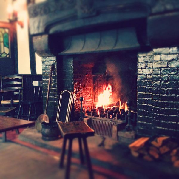 The open fire in the Tudor Bar